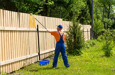 Staining a Fence Using a Paint Roller
