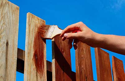 Staining a Fence using a Paintbrush