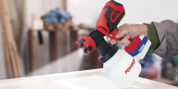 painting-door-using-best-cordless-paint-sprayer